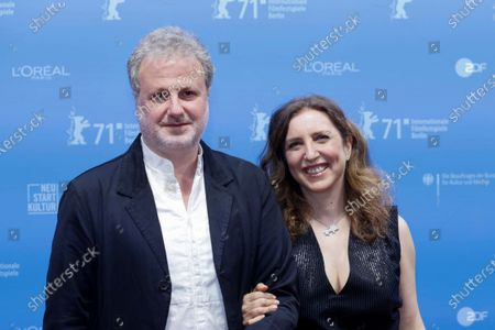 "Directors Joana Hadjithomas, right, and Khalil Joreige pose before a screening of the film ""Memory Box"" at the Berlin International Film Festival in Berlin, Germany"