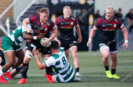 Jackson Wray of Saracens tackled by Rayn Smid (Capt.) of Ealing Trailfinders