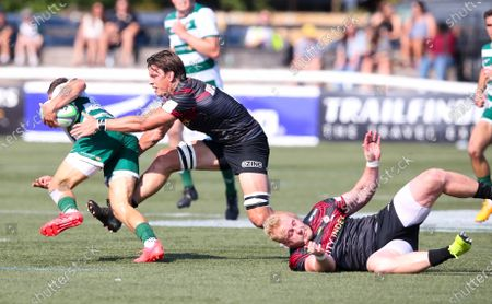 David Johnston of Ealing Trailfinders tries to pass Michael Rhodes of Saracens & Vincent Koch of Saracens (R)