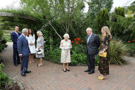 Britain's Queen Elizabeth II, centre, Prince Charles, foeground left, Camilla, the Duchess of Cornwall, fourth left Prince William, background left and Kate the Duchess of Cambridge, second left, stand with Britain's Prime Minister Boris Johnson, centre right and his wife Carrie, during a reception for the G7 leaders at the Eden Project in Cornwall, England, during the G7 summit