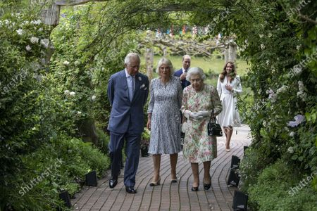 Stock Photo of Britain's Queen Elizabeth II, right, Prince Charles, left, Camilla, the Duchess of Cornwall, centre, Prince William, background left and Kate the Duchess of Cambridge, attend a reception for the G7 leaders at the Eden Project in Cornwall, England, during the G7 summit