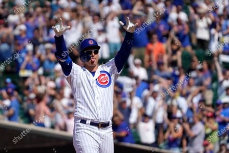 Chicago Cubs' Joc Pederson looks at the dugout and celebrate his two-run double off St. Louis Cardinals relief pitcher Genesis Cabrera during the seventh inning of a baseball game, in Chicago