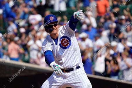 Chicago Cubs' Joc Pederson looks at the dugout and celebrates his two-run double off St. Louis Cardinals relief pitcher Genesis Cabrera during the seventh inning of a baseball game, in Chicago