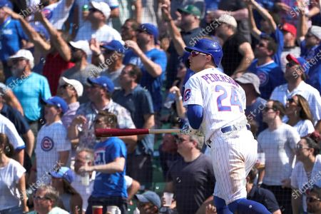 Chicago Cubs' Joc Pederson watches his two-run double off St. Louis Cardinals relief pitcher Genesis Cabrera during the seventh inning of a baseball game, in Chicago
