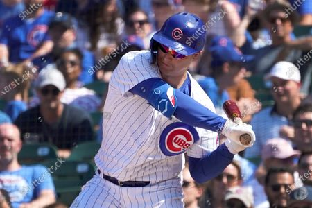 Chicago Cubs' Joc Pederson swings into a two-run double off St. Louis Cardinals relief pitcher Genesis Cabrera during the seventh inning of a baseball game, in Chicago