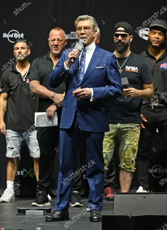 Michael Buffer speaks onstage during the LiveXLive's Social Gloves: Battle Of The Platforms Pre-Fight Weigh-In at Hard Rock Live held