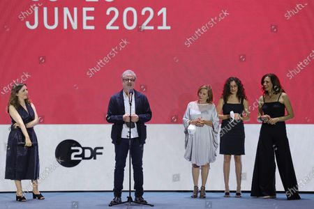 Joana Hadjithomas, Khalil Joreige, Clemence Sabbagh, Paloma Vauthier and Rim Turkhi are seen on stage at the 'Memory Box' premiere during the 71st Berlinale International Film Festival Summer Special at Freiluftkino Museumsinsel in Berlin, Germany, 11 June 2021. Due to the ongoing COVID-19 pandemic, the 71st Berlin International Film Festival is taking place in two stages: an Industry Event in March and the Summer Special for the general public held from June 9 to 20 as an outdoor-only event.