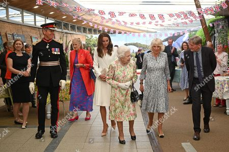 Programme Director at Eden Project, Lindsey Brummitt (L), The Lord-Lieutenant of Cornwall, Edward Bolitho (2nd L) Britain's Catherine Duchess of Cambridge (C), Queen Elizabeth II (3rd R), Britain's Camilla Duchess of Cornwall (2nd R) and Board director of Eden Project, Peter Stewart attend an event in celebration of 'The Big Lunch' initiative at The Eden Project, near St Austell in south west England on June 11, 2021.
