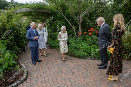 Stock Picture of Britain's Queen Elizabeth II, centre, Prince Charles and Camilla, the Duchess of Cornwall, Prince William and Kate, the Duchess of Cambridge are greeted by Britain's Prime Minister Boris Johnson and his wife Carrie as they arrive at a reception for the G7 leaders at the Eden Project in Cornwall, England, during the G7 summit
