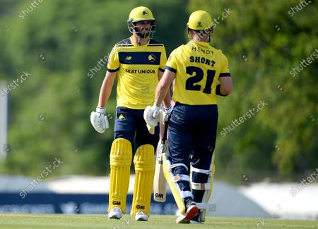 James Vince (left) and D'Arcy Short of Hampshire Hawks during the Vitality T20 Blast match between Middlesex and Hampshire Hawks at Radlett Cricket Club, Radlett