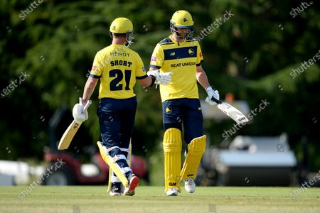 D'Arcy Short and James Vince of Hampshire Hawks during the Vitality T20 Blast match between Middlesex and Hampshire Hawks at Radlett Cricket Club, Radlett