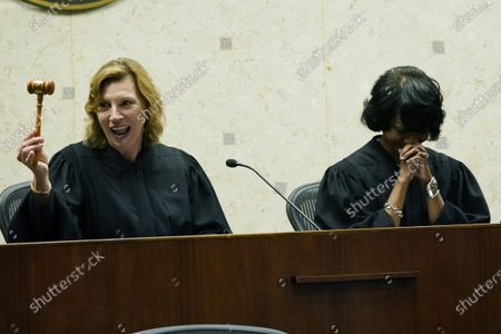 """District Judge Debra M. Brown, right, laughs as outgoing Chief Judge Sharion Aycock offers a joke during a """"gavel passing ceremony"""" in Greenville, Miss., . Brown made history when she became Mississippi's first female African American U.S. District Judge after being appointed by President Barack Obama in 2013, and she becomes the eighth Chief Judge for the Northern District of Mississippi and the first African American female Chief Judge in Mississippi"""