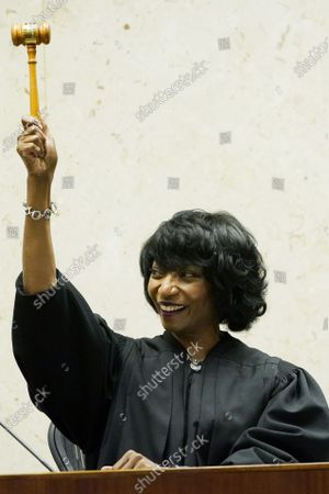 """New U.S. District Chief Judge Debra M. Brown, waves the gavel given to her by outgoing Chief Judge Sharion Aycock, unseen, during a """"gavel passing ceremony"""" in Greenville, Miss., . Brown made history when she became Mississippi's first female African American U.S. District Judge after being appointed by President Barack Obama in 2013, and she becomes the eighth Chief Judge for the Northern District of Mississippi and the first African American female Chief Judge in Mississippi"""
