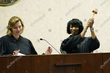"""New U.S. District Chief Judge Debra M. Brown, right, waves the gavel given to her by outgoing Chief Judge Sharion Aycock during a """"gavel passing ceremony"""" in Greenville, Miss., . Brown made history when she became Mississippi's first female African American U.S. District Judge after being appointed by President Barack Obama in 2013, and she becomes the eighth Chief Judge for the Northern District of Mississippi and the first African American female Chief Judge in Mississippi"""