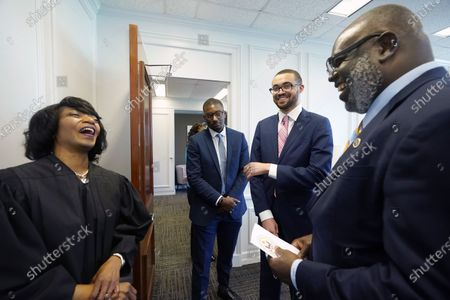 """Stock Image of New U.S. District Chief Judge Debra M. Brown, for the Northern District, left, jokes with District Judge Carlton Reeves for the Southern District of Mississippi, right, his law clerk George Brewster, second from left, and student James Minor, following a """"gavel passing ceremony"""" in Greenville, Miss., . Brown made history when she became Mississippi's first female African American U.S. District Judge after being appointed by President Barack Obama in 2013, and she becomes the eighth Chief Judge for the Northern District of Mississippi and the first African American female Chief Judge in Mississippi"""