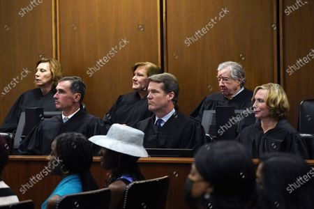 """Stock Photo of Judges from the U.S. District Court for the Northern District of Mississippi watch as Judge Debra M. Brown, unseen, is given the gavel from outgoing Chief Judge Sharion Aycock during a """"gavel passing ceremony"""" in Greenville, Miss., . Brown made history when she became Mississippi's first female African American U.S. District Judge after being appointed by President Barack Obama in 2013, and she becomes the eighth Chief Judge for the Northern District of Mississippi and the first African American female Chief Judge in Mississippi"""