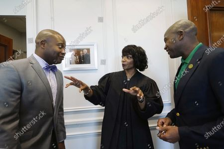 """New U.S. District Chief Judge Debra M. Brown for the Northern District, center, confers with State Sen. Derrick Simmons, D-Greenville, left, and his brother Greenville Mayor Errick Simmons, following a """"gavel passing ceremony"""" in Greenville, Miss., . Brown made history when she became Mississippi's first female African American U.S. District Judge after being appointed by President Barack Obama in 2013, and she becomes the eighth Chief Judge for the Northern District of Mississippi and the first African American female Chief Judge in Mississippi"""