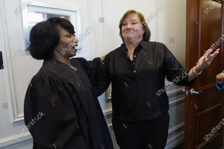 """New U.S. District Chief Judge Debra M. Brown for the Northern District, left, jokes with Judge Selene D. Maddox, a United States Bankruptcy Judge for the Northern District following a """"gavel passing ceremony"""" in Greenville, Miss., . Brown made history when she became Mississippi's first female African American U.S. District Judge after being appointed by President Barack Obama in 2013, and she becomes the eighth Chief Judge for the Northern District of Mississippi and the first African American female Chief Judge in Mississippi"""