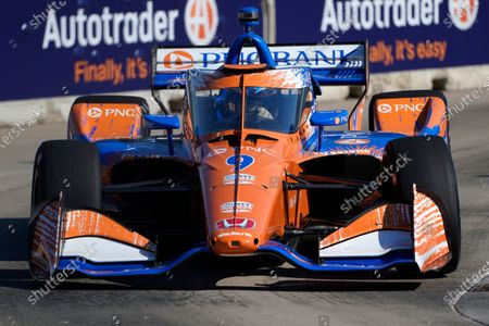 Scott Dixon, of New Zealand, practices for the IndyCar Detroit Grand Prix auto racing doubleheader on Belle Isle in Detroit