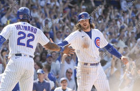 Chicago Cubs Jason Heyward (22) and Jake Marisnick (6) celebrate scoring during the 7th inning on a double by Joc Pederson (24) against the St. Louis Cardinals at Wrigley Field on Friday, June 11, 2021. The Chicago Cubs were able to host fans at 100% capacity in Wrigley Field for the first time since September 22, 2019, which was also against the Cardinals. The Chicago Cubs defeated the St. Louis Cardinals 8-5.
