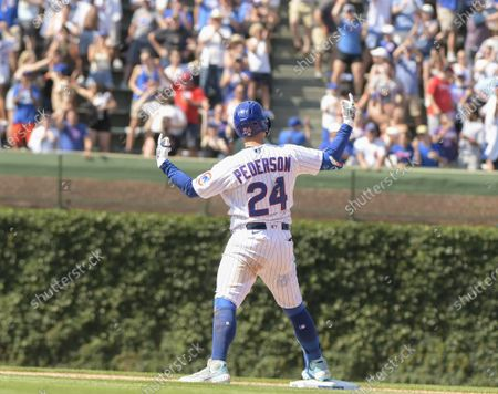 Stock Picture of Chicago Cubs left fielder Joc Pederson (24) celebrates his 2 run RBI double in the 7th inning against the St. Louis Cardinals at Wrigley Field on Friday, June 11, 2021. The Chicago Cubs were able to host fans at 100% capacity in Wrigley Field for the first time since September 22, 2019, which was also against the Cardinals. The Chicago Cubs defeated the St. Louis Cardinals 8-5.