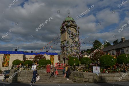 The Clock Tower and The Square, decorated with flowers in the village of Enniskerry in County Wicklow. There are only two more days until filming begins for Disney's 'Disappointed,' starring Amy Adams, Patrick Dempsey, James Marsden, Idina Menzel and Maya Rudolph.A team of carpenters, painters, builders and decorators put the finishing touches to make parts of the village look like a magical Disney wonderland.On Friday, 11 June 2021, in Enniskerry, County Wicklow, Ireland.