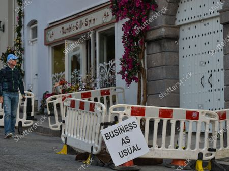 A sign 'Business as usual' seen outside business premises in the village of Enniskerry in County Wicklow. There are only two more days until filming begins for Disney's 'Disappointed,' starring Amy Adams, Patrick Dempsey, James Marsden, Idina Menzel and Maya Rudolph.A team of carpenters, painters, builders and decorators put the finishing touches to make parts of the village look like a magical Disney wonderland.On Friday, 11 June 2021, in Enniskerry, County Wicklow, Ireland.