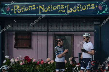 Two cyclists enjoy a drink in front of a flower-decorated local pharmacy in the village of Enniskerry, Co. Wicklow.There are only two more days until filming begins for Disney's 'Disappointed,' starring Amy Adams, Patrick Dempsey, James Marsden, Idina Menzel and Maya Rudolph.A team of carpenters, painters, builders and decorators put the finishing touches to make parts of the village look like a magical Disney wonderland.On Friday, 11 June 2021, in Enniskerry, County Wicklow, Ireland.