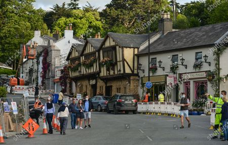 Visitors walking around the main street with trannsformed houses decorated with flowers in the village of Enniskerry in County Wicklow. There are only two more days until filming begins for Disney's 'Disappointed,' starring Amy Adams, Patrick Dempsey, James Marsden, Idina Menzel and Maya Rudolph.A team of carpenters, painters, builders and decorators put the finishing touches to make parts of the village look like a magical Disney wonderland.On Friday, 11 June 2021, in Enniskerry, County Wicklow, Ireland.