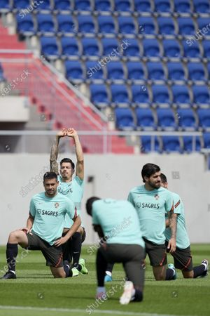 Portugal's national soccer team players Raphael Guerreiro (L), Jose Fonte (C) and Ruben Neves (R) in action during a training session at the Illovszky Rudolf Stadium, Budapest, Hungary, 12 June 2021. Portugal will face Hungary in their UEFA EURO 2020 group F round soccer match on 15 June 2021.