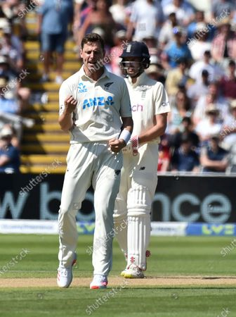 New Zealand's Matt Henry, left, celebrates the dismissal of England's Rory Burns during the third day of the second cricket test match between England and New Zealand at Edgbaston in Birmingham, England, . On the right is England's Dom Sibley