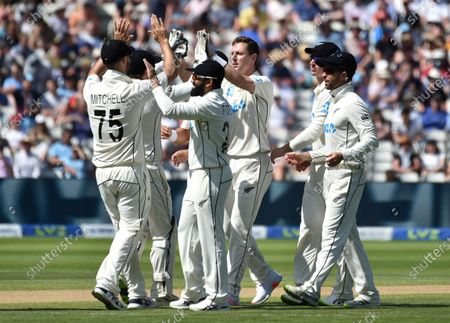 New Zealand's Matt Henry, third right, celebrates with teammates the dismissal of England's Rory Burns during the third day of the second cricket test match between England and New Zealand at Edgbaston in Birmingham, England