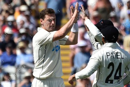 New Zealand's Matt Henry, left, celebrates with teammates the dismissal of England's Rory Burns during the third day of the second cricket test match between England and New Zealand at Edgbaston in Birmingham, England