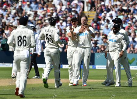 New Zealand's Matt Henry, third right, celebrates with teammates the dismissal of England's Dom Sibley during the third day of the second cricket test match between England and New Zealand at Edgbaston in Birmingham, England