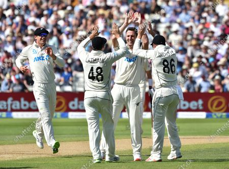 New Zealand's Matt Henry, second right, celebrates with teammates the dismissal of England's Zak Crawley during the third day of the second cricket test match between England and New Zealand at Edgbaston in Birmingham, England