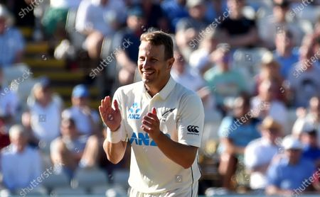 New Zealand's Neil Wagner celebrates the dismissal of England's Mark Wood during the third day of the second cricket test match between England and New Zealand at Edgbaston in Birmingham, England