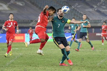 (210612) - KUWAIT CITY, June 12, 2021 (Xinhua) - Gautam Shrestha (Front, L) of Nepal lives with Mathew Leckie of Australia during the Group B second round football match between Nepal and Australia at FIFA World Cup Qatar 2022 and AFC Asian Cup 2023 Preliminary Joint Qualification in Kuwait City, Kuwait, June 11, 2021.