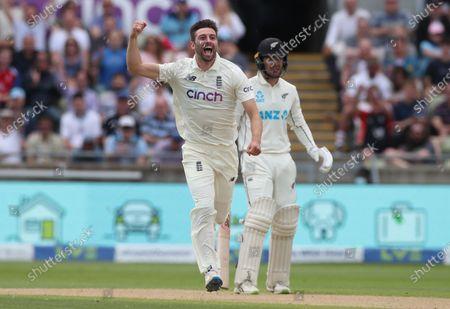 Mark Wood of England celebrates taking the wicket of Henry Nicholls of New Zealand