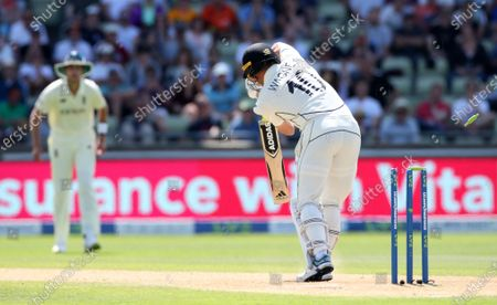 Neil Wagner of New Zealand is bowled by Jimmy Anderson of England