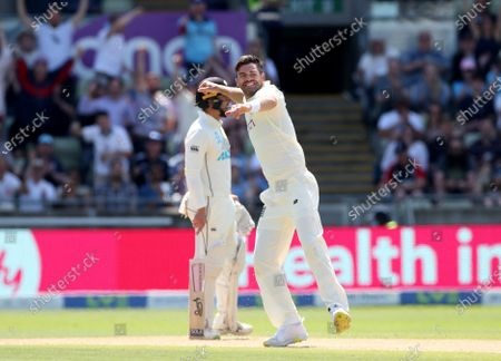 Jimmy Anderson of England celebrates taking the wicket of Neil Wagner of New Zealand