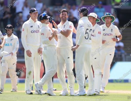 Jimmy Anderson of England celebrates with his teammates after taking the wicket of Neil Wagner of New Zealand