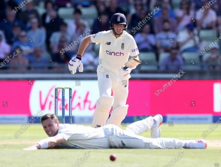 Joe Root of England takes off for runs after hitting the ball past bowler Matt Henry of New Zealand