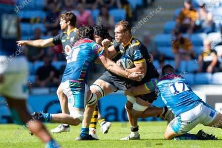 Wasps captain Brad Shields is tackled by James Whitcombe of Leicester Tigers