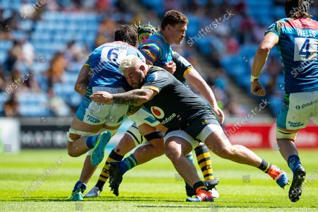 Kieran Brookes, making his final appearance for Wasps, tackles George Martin of Leicester Tigers