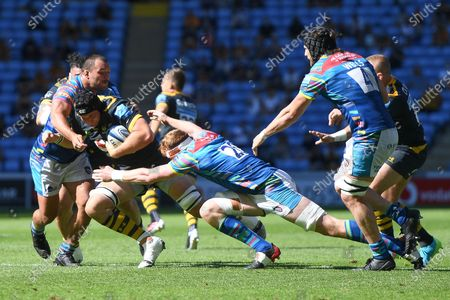 Wasps lock Tim Cardall (19) is tackled by Leicester Tigers prop Ellis Genge (1) and Leicester Tigers back row Ollie Chessum (20) during the Gallagher Premiership Rugby match between Wasps and Leicester Tigers at the Ricoh Arena, Coventry