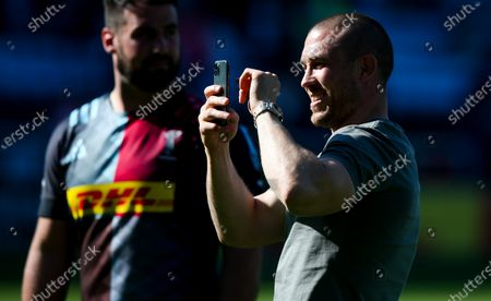 Mike Brown takes a video of the crowd as he says goodbye to the Stoop and Quins  as he leaves the club to move to Newcastle