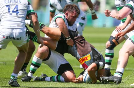 Stock Picture of Danny Care of Harlequins is tackled by George McGuigan of Newcastle