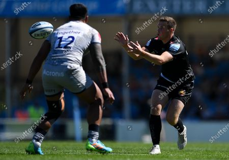 Joe Simmonds of Exeter Chiefs is marked by Manu Tuilagi of Sale Sharks