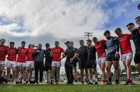 Stock Image of Carlow vs Louth. Louth manager Mickey Harte speaks to his players after the match.