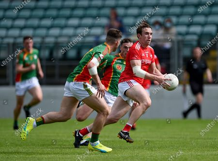 Carlow vs Louth. Louth's Bevan Duffy with Josh Moore and Jordan Morrissey of Carlow